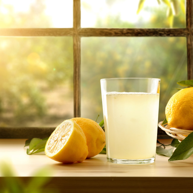 """Homemade lemonade on kitchen with window and orchard outside"" stock image"