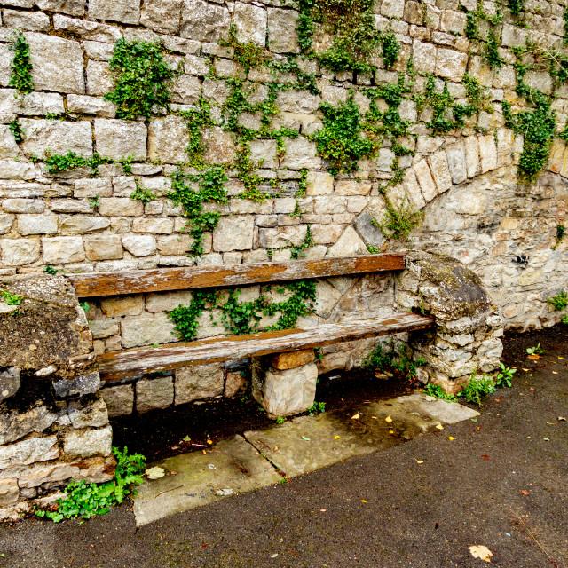 """Bench Seat on Castle Walk below Richmond Castle, Yorkshire."" stock image"