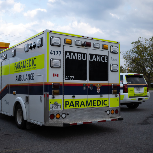 """Ottawa Paramedic Service ambulence and vehicle"" stock image"