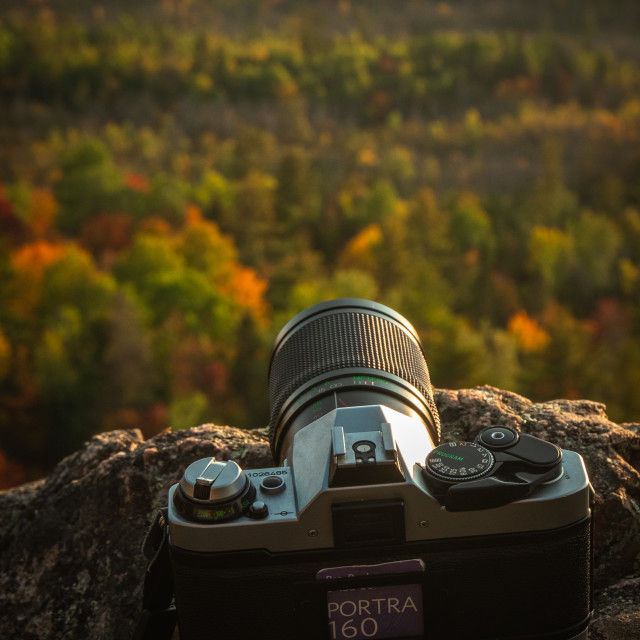 """Analog Camera with Kodak film shooting landscape"" stock image"