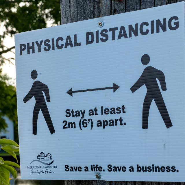 """""""Physical Distancing sign in Ontario town"""" stock image"""