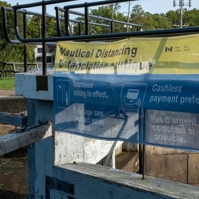 """Nautical Distancing banner at Rideau lockstation"" stock image"