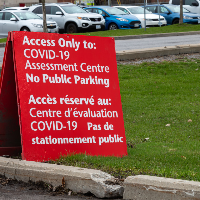 """""""COVID-19 Assessment Centre parking sign in Ottawa"""" stock image"""
