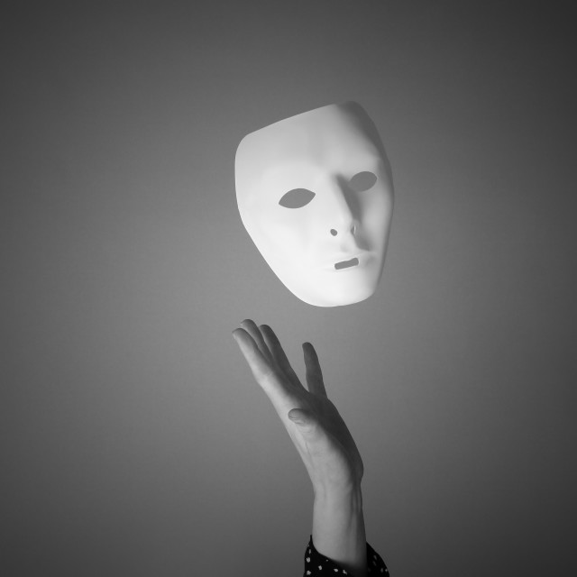 """The mask is a symbol of duplicity"" stock image"