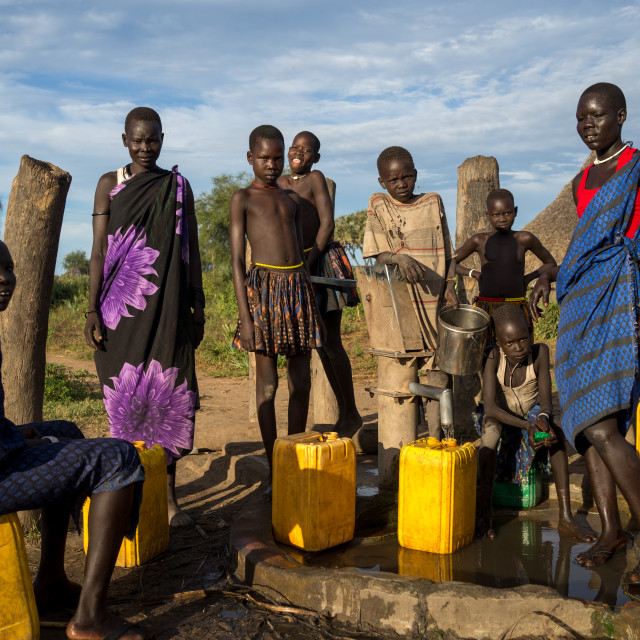 """Mundari tribe women pumping water in a well, Central Equatoria, Terekeka,..."" stock image"