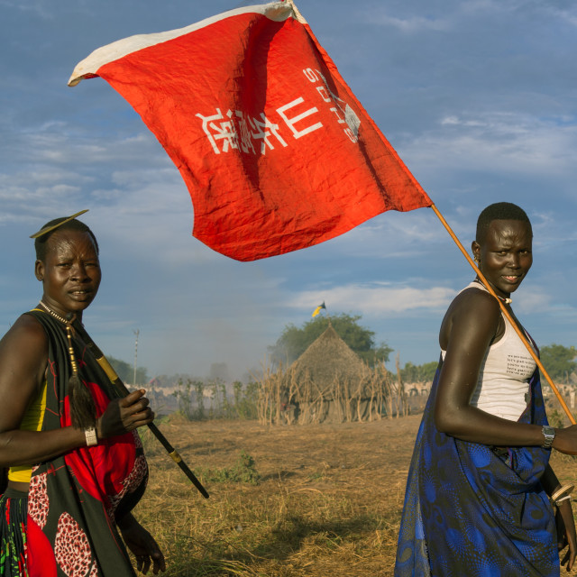 """""""Mundari tribe women with a chinese flag celebrating a wedding, Central..."""" stock image"""