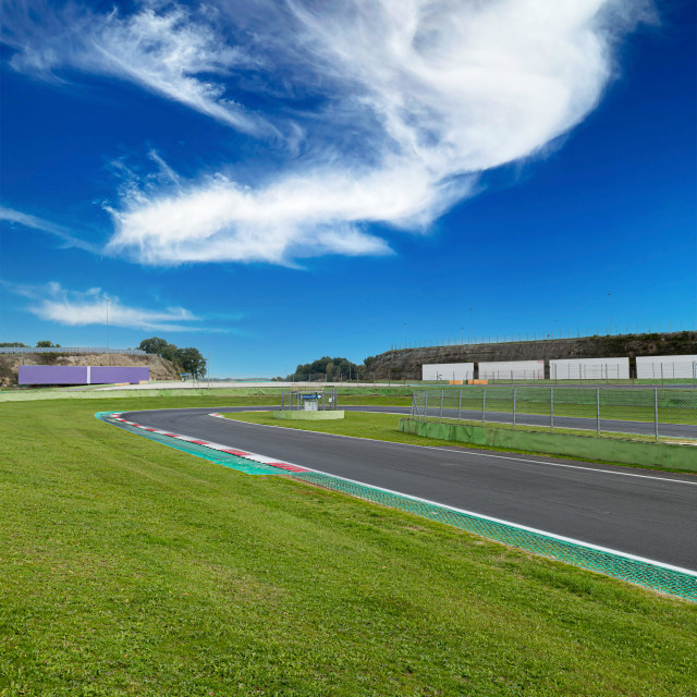 """""""Hairpin bend and turn exit with curb and green field on motor sp"""" stock image"""