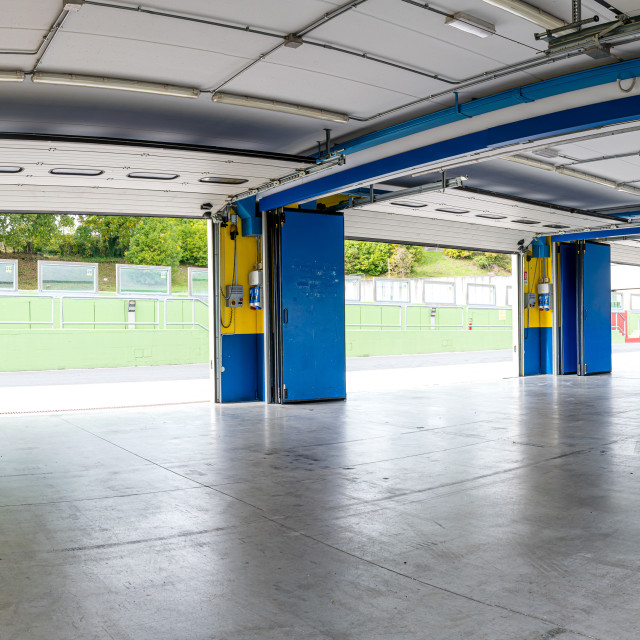 """Workshop box space motor sport circuit empty no people, pit lane"" stock image"