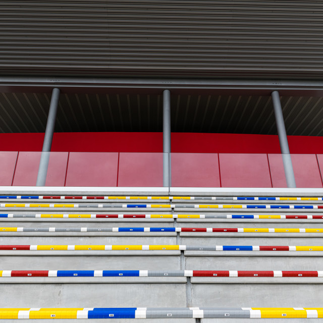 """""""Multicolored seats row of bleachers grandstands empty no people"""" stock image"""