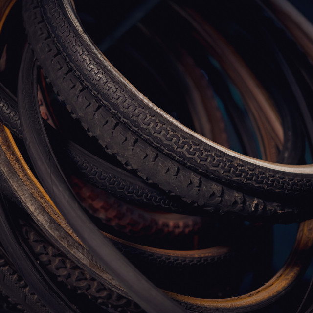 """""""Detail of old bicycle tire hanging in abandoned workshop"""" stock image"""