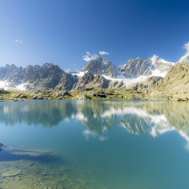 """""""Bernina Group mountains mirrored in the clear water of Forbici lake,..."""" stock image"""