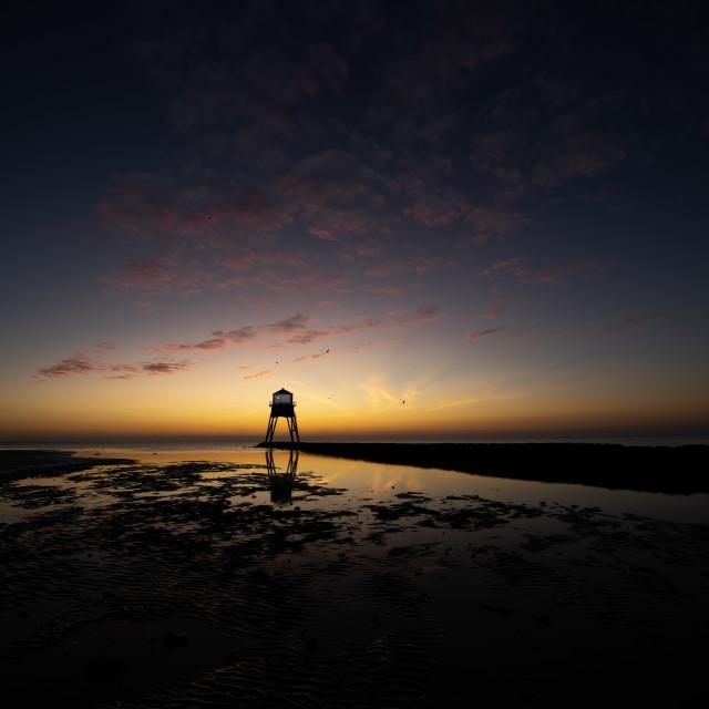 """First Light Dovercourt Beach"" stock image"