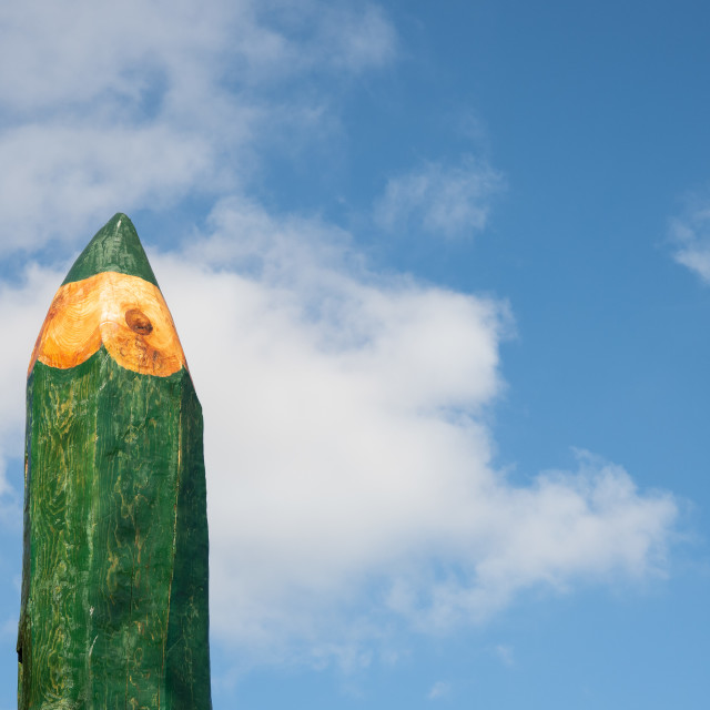"""""""School and drawing concept big green pencil against blue sky"""" stock image"""