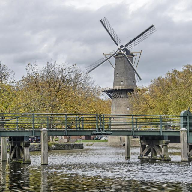 """Windmill and bridge in autumn"" stock image"