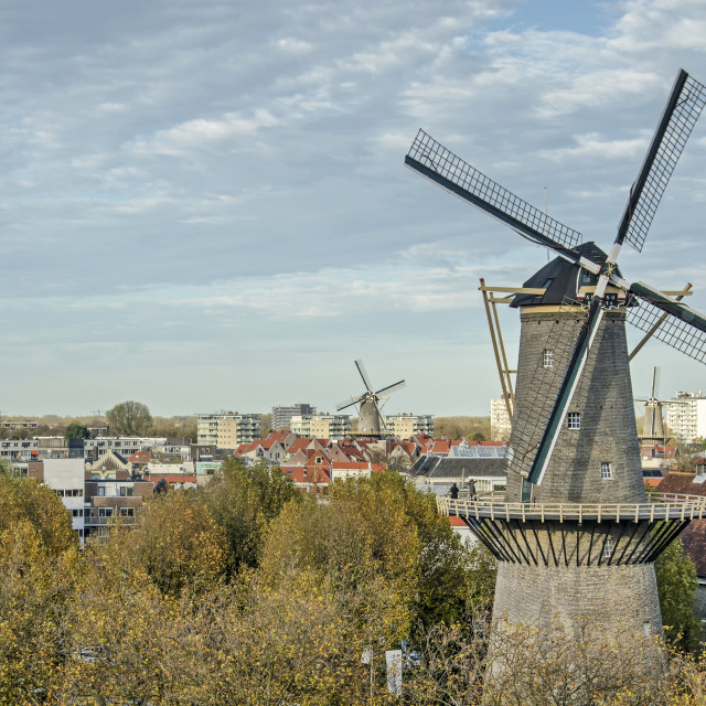 """""""Windmill and old town"""" stock image"""