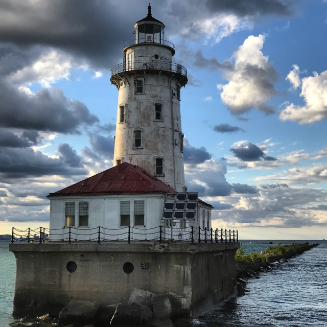 """""""Chicago Harbor Lighthouse under a cloudy sky"""" stock image"""