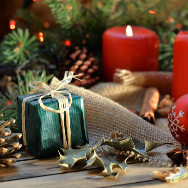 """""""traditional christmas decoration on wooden background with candles and gifts in blur lights"""" stock image"""