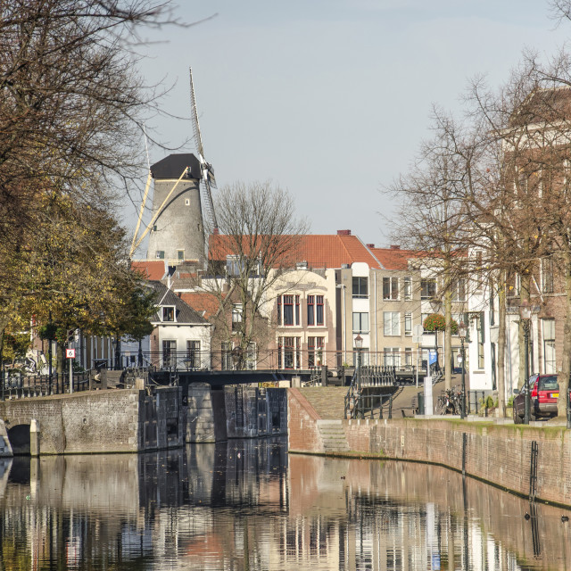 """Schiedam canal, sluice and windmill"" stock image"