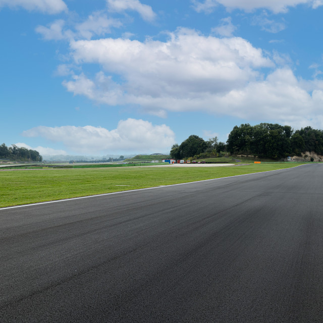 """Asphalt straight track empty and green field on motor sport circ"" stock image"