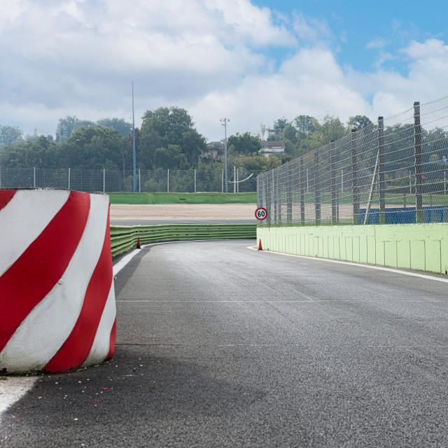 """Pit lane entry asphalt track motor sport circuit with separation"" stock image"