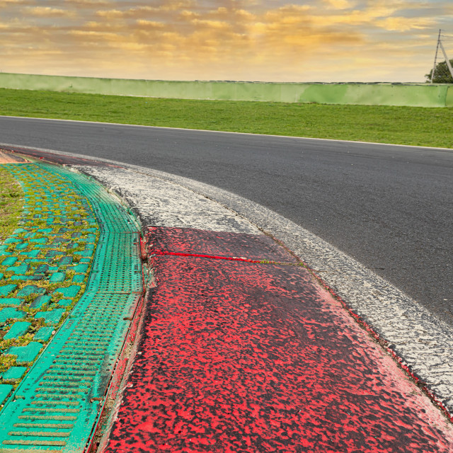 """""""Close up of rough curb at left turn on motor sport track with gr"""" stock image"""