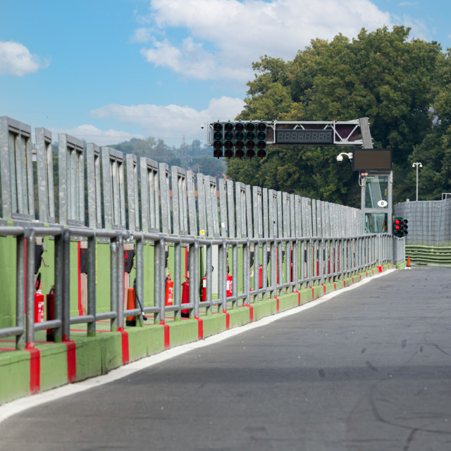 """""""Motor sport circuit empty pit lane exit rear view, wall and red"""" stock image"""