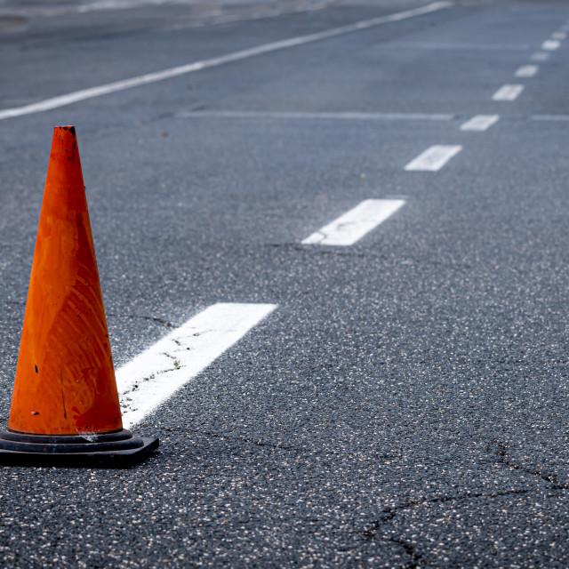 """Different direction dividing line traffic cone on asphalt track"" stock image"