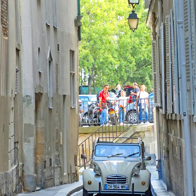 """""""2CV heading away from Notre Dame Paris France"""" stock image"""