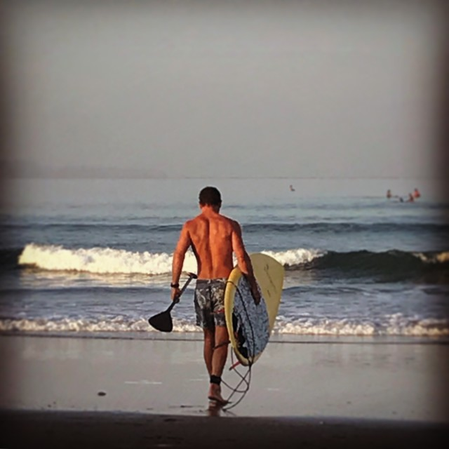 """""""Surfing in Bali"""" stock image"""