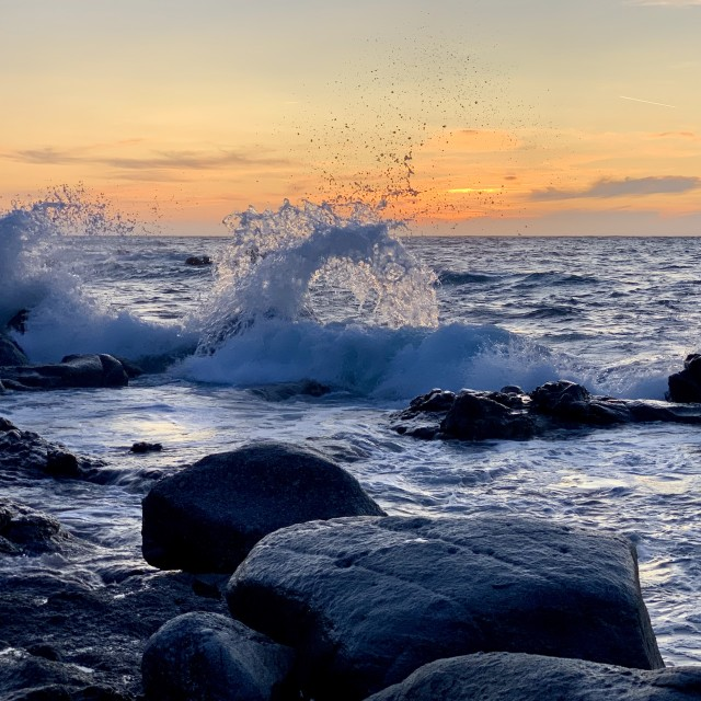 """""""Waves breaking on the rocks at sunset, Corsica."""" stock image"""