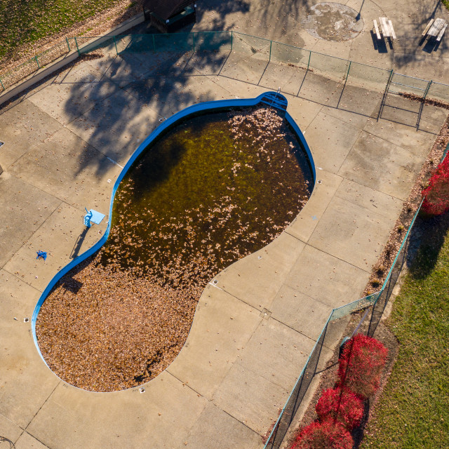 """""""Aerial drone photo of an uncovered swimming pool filled with fallen autumn..."""" stock image"""