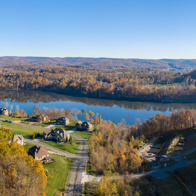 """""""Aerial view of single family homes by Cheat Lake in the fall outside..."""" stock image"""