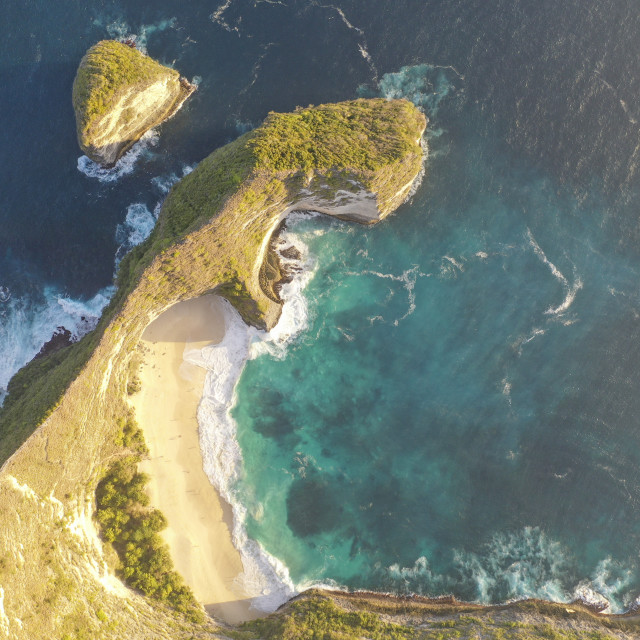 """""""Aerial view the beautiful Kelingking Beach aka Mantay Bay. The famous beach among tourist for hiking, snorkeling & hiking. Big waves, majestic beach and natural view in Nusa Penida, Bali, Indonesia."""" stock image"""
