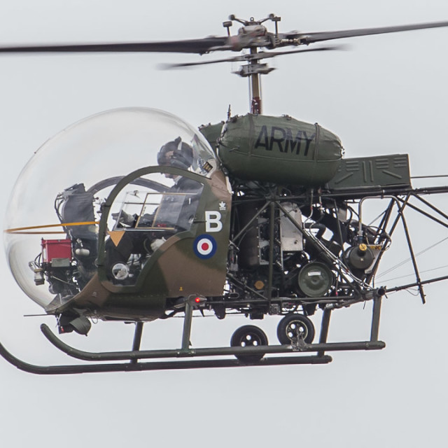 """""""An ex Army Air Corps Sioux helicopter at RNAS Yeovilton."""" stock image"""