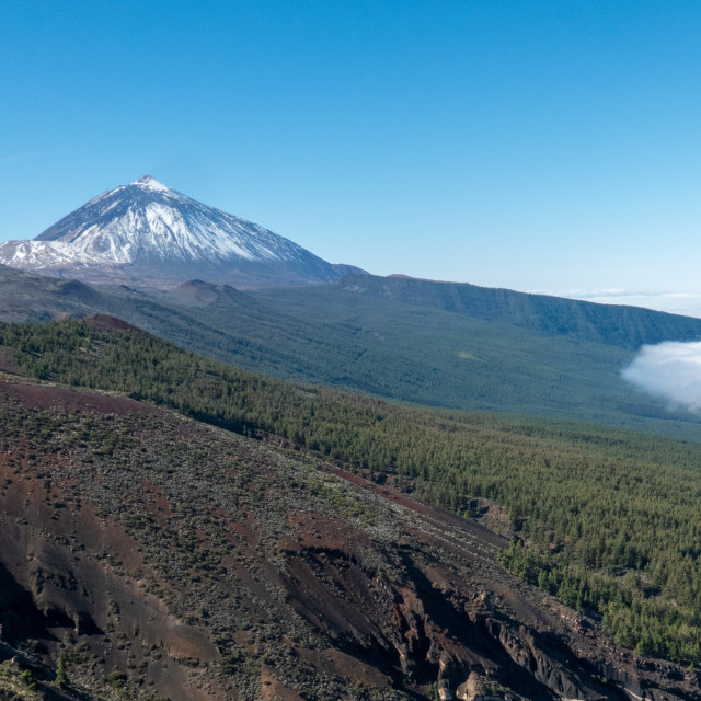 """""""Mount Tiede poking from the clouds"""" stock image"""