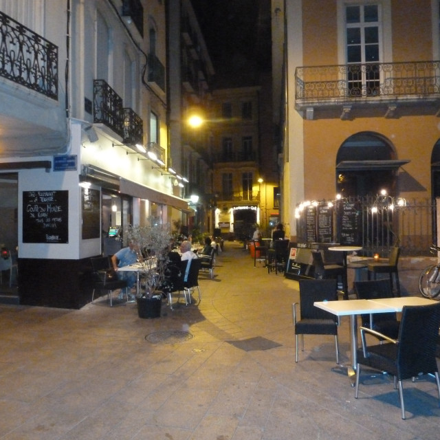 """Nightime cafe in Perpignan France"" stock image"