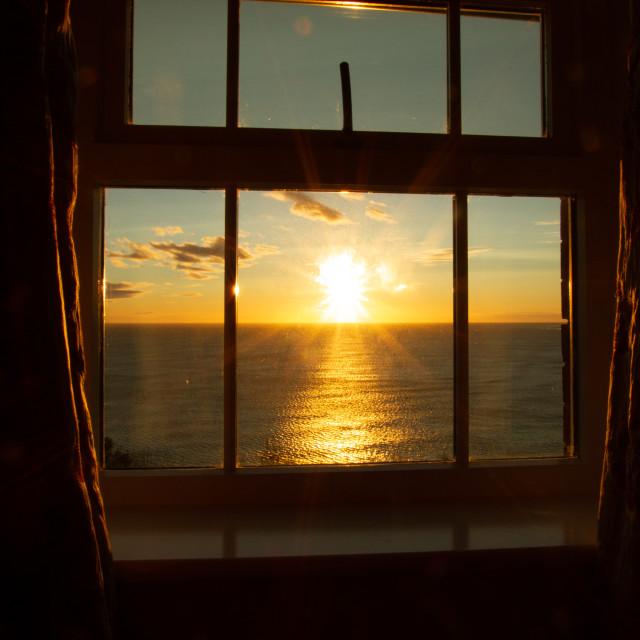 """Robin Hoods Bay, Spectacular Sunrise through the window"" stock image"