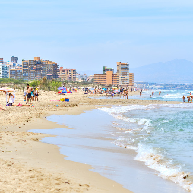 """""""People on the sandy beach of Los Arenales del Sol, Spain"""" stock image"""