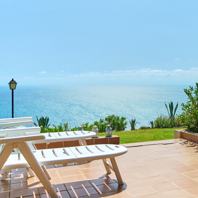 """""""Terrace with deckchairs potted plants and sea view"""" stock image"""