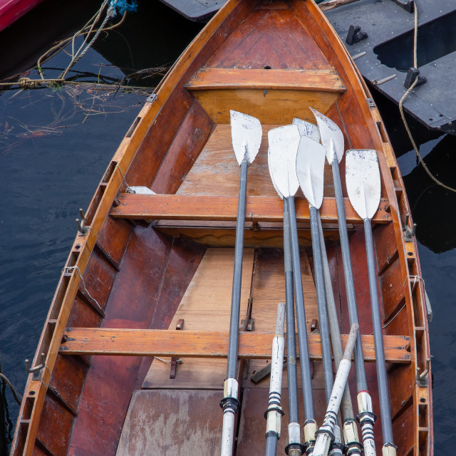 """""""Wooden rowing boat for hire, moored on the River Thames, London,"""" stock image"""