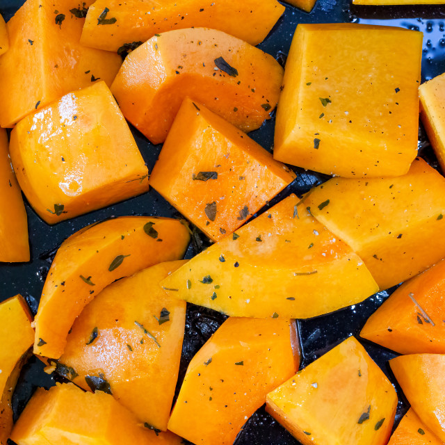 """""""Butternut squash chunks on a baking tray"""" stock image"""