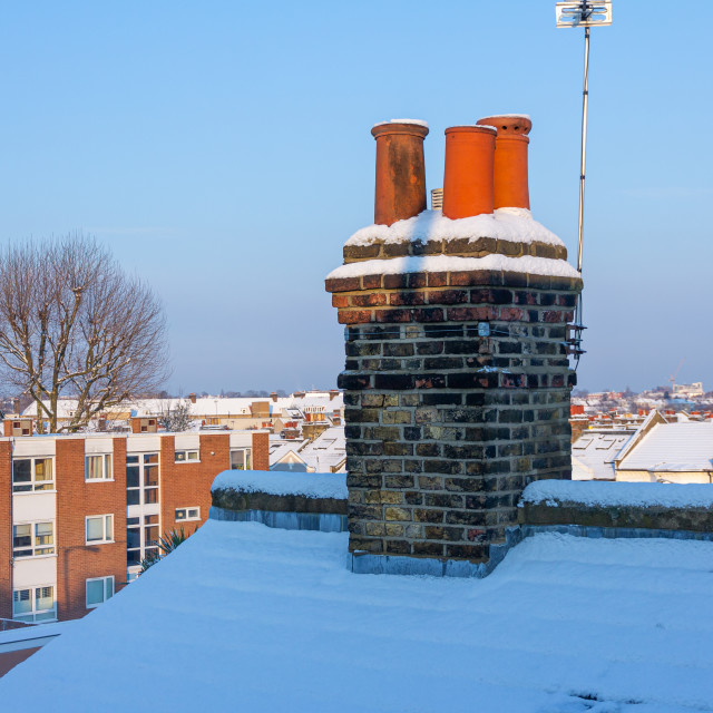 """""""Chimney pots covered in snow"""" stock image"""
