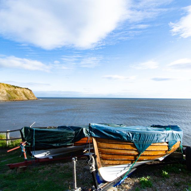 """""""Small Fishing Boats on Trailers Parked Overlooking Robin Hoods Bay, Yorkshire."""" stock image"""