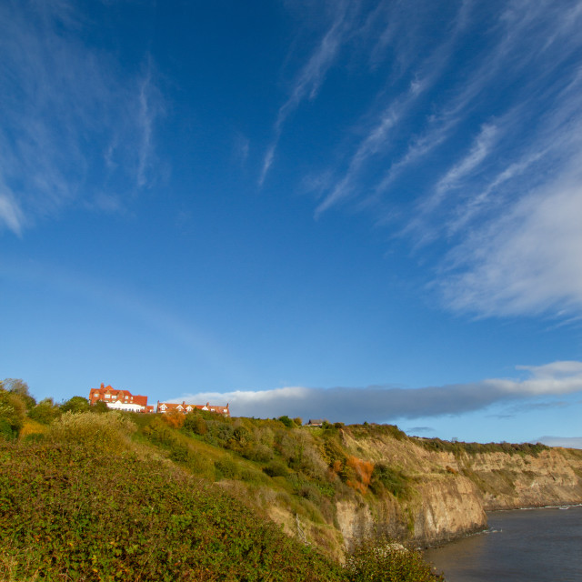 """""""View of the cliffs and sea at Robin Hoods Bay on a Sunny Blue Sky Morning."""" stock image"""