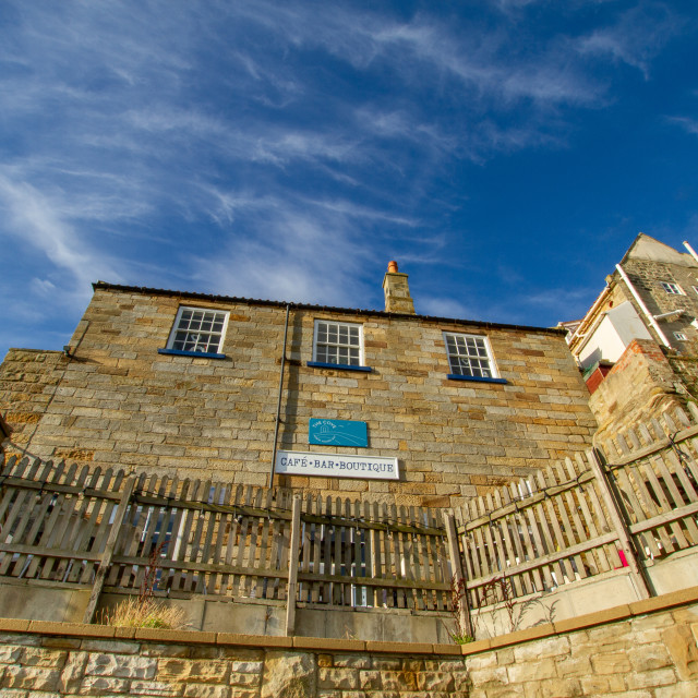 """""""The Cove, Cafe Bar Venue, Robin Hoods Bay, Yorkshire, External rear view on a sunny day."""" stock image"""