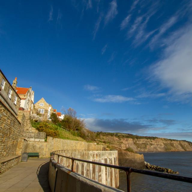"""Robin Hoods Bay, Yorkshire, sea wall walk/pathway"" stock image"