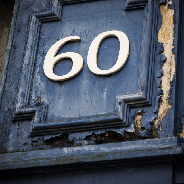 """""""Number sixty on weather painted blue door"""" stock image"""