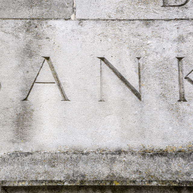 """""""Elegant bank sign carved in to stone wall"""" stock image"""