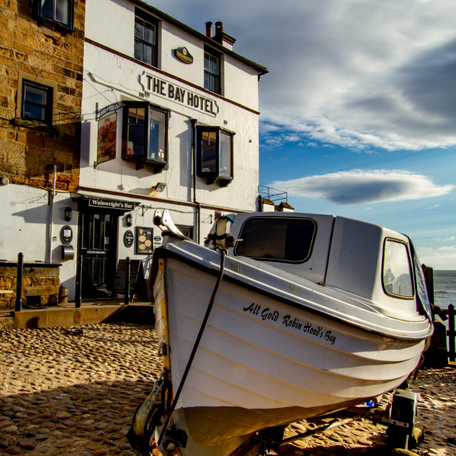 """""""Robin Hoods Bay, Yorkshire. Fishing boat on trailer in front of The Bay Hotel."""" stock image"""