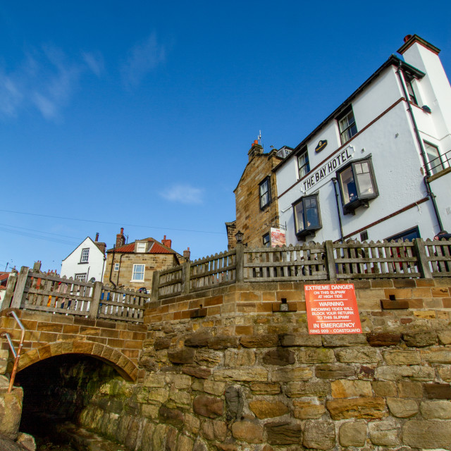 """""""The Bay Hotel and smugglers tunnel, Robin Hoods Bay, Yorkshire, England."""" stock image"""